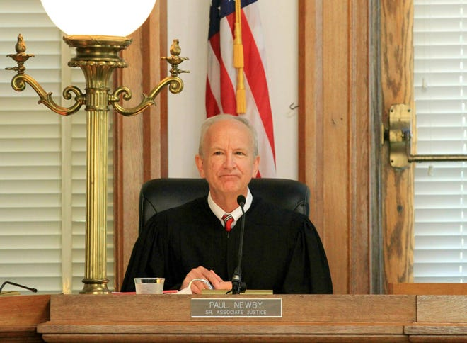 FILE - In this May 15, 2019, file photo, Senior Associate Justice Paul Newby presides at a special session of the Supreme Court of North Carolina at New Bern City Hall in New Bern. (Gray Whitley/Sun Journal via AP, File)