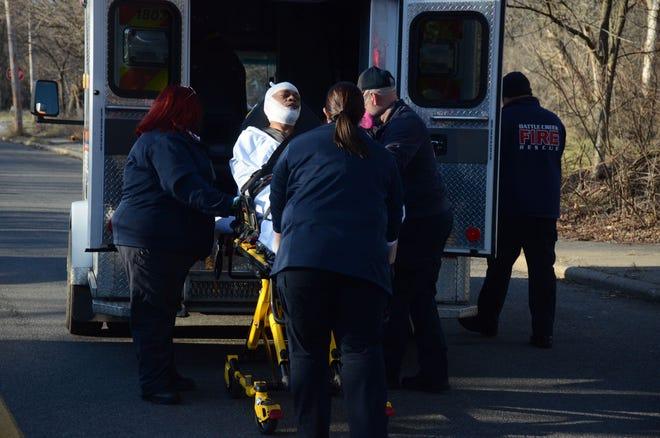 A victim in a Thursday, Dec. 10, 2020 assault in Battle Creek is taken to the hospital by Lifecare Ambulance paramedics.