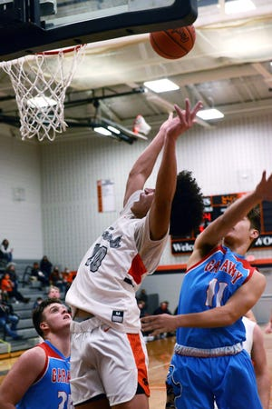 Kigenn Millender goes up for a shot in traffic during Ridgewood's 62-59 overtime win against visiting Garaway on Friday night in West Lafayette.