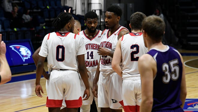 The USI men's basketball team discusses a play during Saturday's 81-70 victory over McKendree.