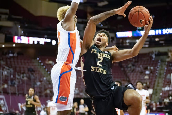 Florida State's Anthony Polite drives against the Florida Gators in Tallahassee, Fla., on Dec. 12, 2020.