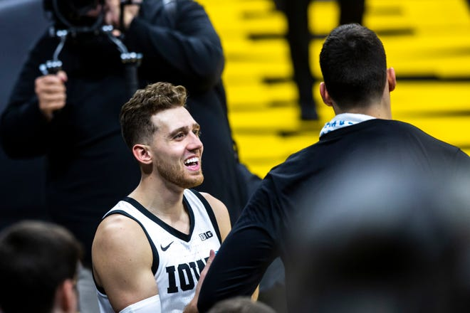Iowa guard Jordan Bohannon, left, has been among the nation's most outspoken advocates for name, image and likeness rights among athletes, even meeting this spring with NCAA president Mark Emmert on the issue.