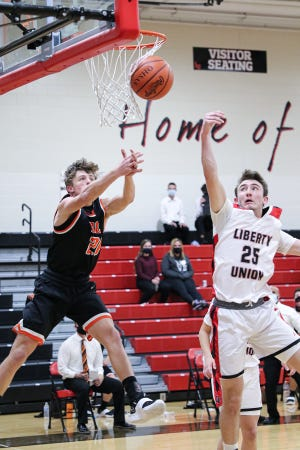 Liberty Union's Jacob Miller attempts to intercept a pass intended for Amanda Clearcreek's Tayvon Miller Friday night at LUHS. LIberty Union prevailed 52-46.