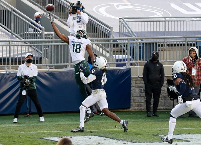 Michigan State receiver Tre'Von Morgan (18) reaches for a pass in the end zone during the fourth quarter against the Penn State at Beaver Stadium, Dec. 12, 2020, in University Park, Pa. (Matthew OHaren-USA TODAY Sports)