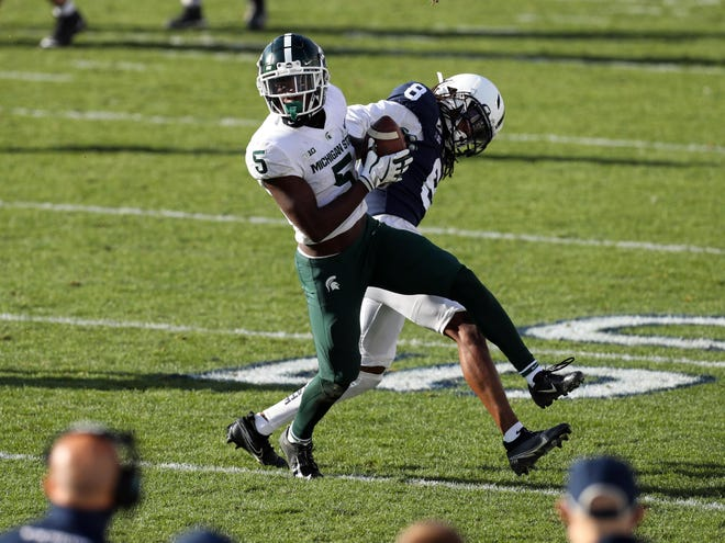 Dec 12, 2020; University Park, Pennsylvania, USA; Michigan State Spartans wide receiver Jayden Reed (5) makes a catch during the second quarter against the Penn State Nittany Lions at Beaver Stadium.