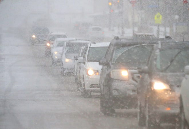 Traffic is stopped on Pilgrim Road near Main Street in Menomonee Falls