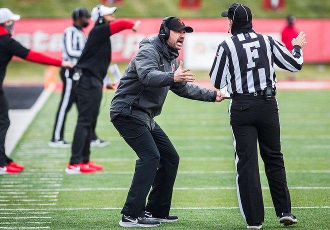 Head coach Mike Neu speaks to an official after a call in the fourth quarter of their game against Western Michigan at Scheumann Stadium Saturday, Dec. 12, 2020.
