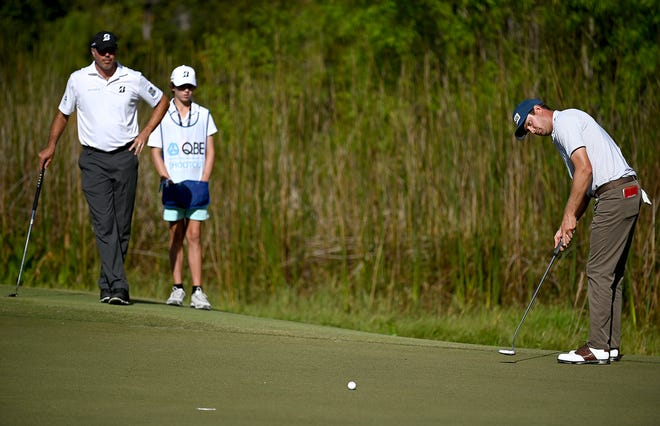 Matt Kuchar and his caddy watching Harris English's putt on the 8th green during the QBE Shootout at the Tiburón Golf Club in Naples ,Saturday,Dec.12,2020.( Photo/Chris Tilley/Special to the Naples Daily News)