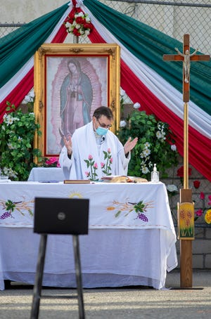 Father David Foxen leads a special Lady of Guadalupe mass at Our Lady of Solitude Church in Palm Springs, Calif., on Saturday, December 12, 2020. The annual 34-mile Virgen de Guadalupe pilgrimage from Palm Springs to Coachella didn't happen this year due to the coronavirus pandemic.