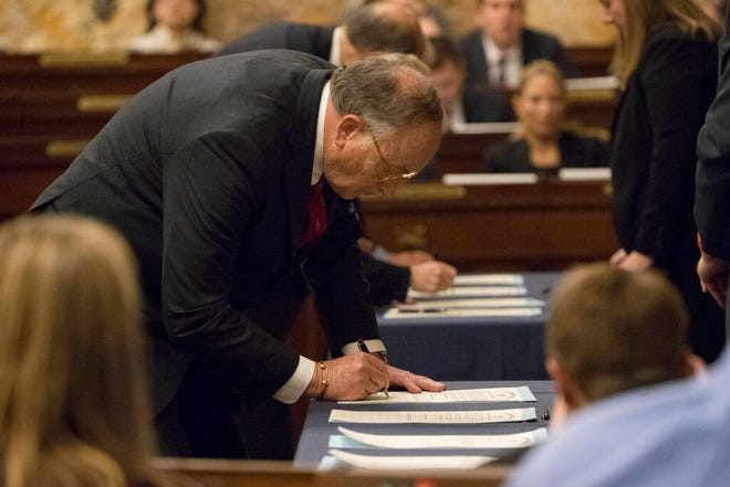 FILE—In this file photo from Dec. 19, 2016, elector Robert Gleason certifies the results during Pennsylvania's 58th Electoral College at the state Capitol in Harrisburg, Pa., Monday, Dec. 19, 2016. In 2016, the 20 unbound Electoral College members from Pennsylvania gathered in Harrisburg for Republican President-elect Donald Trump under pressure from Democrats to flip their vote to Democrat Hillary Clinton. This year, the 20 unbound Electoral College members from Pennsylvania will gather Monday in Harrisburg for Democratic President-elect Joe Biden, amid efforts by Trump to reverse the election result. (AP Photo/Matt Rourke, File)