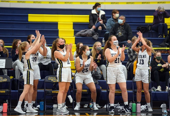 The Tea Area girls basketball team cheers as they pull ahead in their game against Dakota Valley on Friday, December 11, at Tea Area High School.