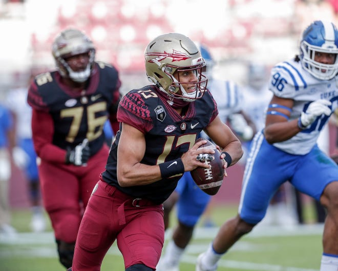 TALLAHASSEE, FL - December 12: Quarterback Jordan Travis #13 of the Florida State Seminoles on a running play during the game against the Duke Blue Devils at Doak Campbell Stadium on Bobby Bowden Field on December 12, 2020 in Tallahassee, Florida. (Photo by Don Juan Moore/Character Lines)