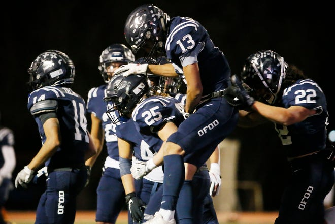 Del Valle celebrates a touchdown during the game against Lubbock Monterey in a Class 5A, Division I bidistrict playoff game Friday, Dec. 11, at Del Valle High School in El Paso.