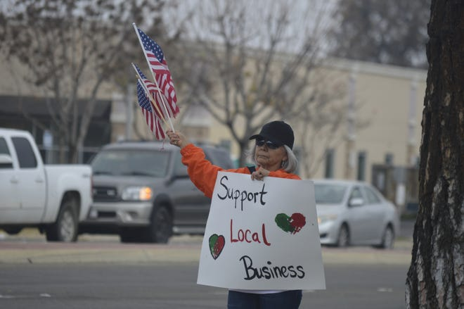 Tulare County residents rally on Dec. 12, 2020 to support small local businesses. Gov. Gavin Newsom's recent regional stay-at-home order restricted indoor restaurant dining.