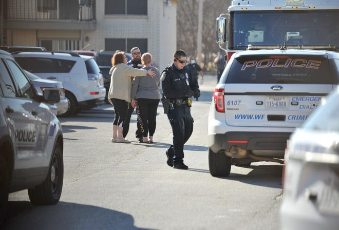 Wichita Falls Police work the scene of a homicide Saturday morning.
