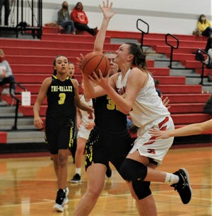Sheridan's Faith Stinson goes up for a shot against Tri-Valley's Tailor Dupler on Friday night. The Generals won 40-38.
