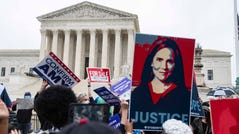 Demonstrators for and against President Trump's Supreme Court nominee Amy Coney Barrett gather outside the Supreme Court on the first day of Senate confirmation hearings for Barrett on Monday, Oct. 12, 2020, in Washington D.C.