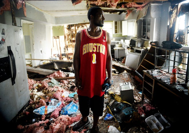 """Howard Wallace, whose Lake Charles, La., house was destroyed in Hurricane Laura, comes back to his house to check on what is left the day that Hurricane Delta will make landfall on Friday, October 9, 2020. """"My fingers are crossed and I'm prayed up,"""" said Wallace."""
