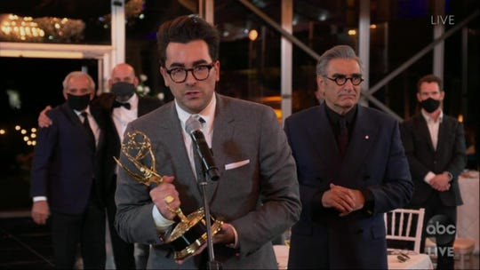 """Daniel Levy accepts the award for outstanding comedy series for """"Schitt's Creek"""" in a video grab from the 72nd Emmy Awards telecast on ABC on Sept. 20, 2020."""