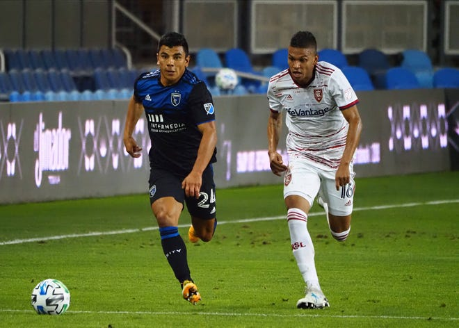 Defender Nick Lima (29) drives down the field for the San Jose Earthquakes ahead of Real Salt Lake midfielder Maikel Chang during the first half of a match at Earthquakes Stadium Oct 28, 2020.