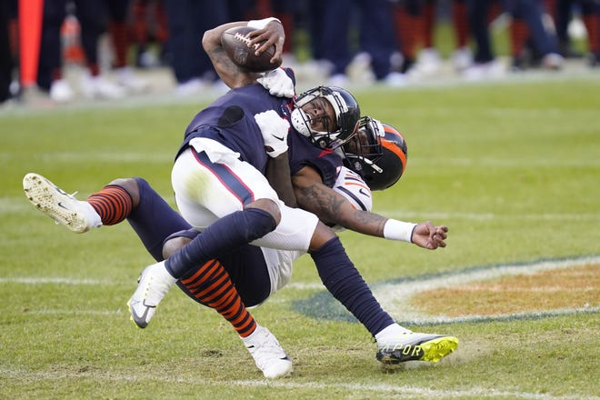 Houston Texans quarterback Deshaun Watson is sacked by Chicago Bears' Mario Edwards during the Bears' 36-7 win Sunday in Chicago. Watson was 21 of 30 for 219 yards after three straight games with more than 300.