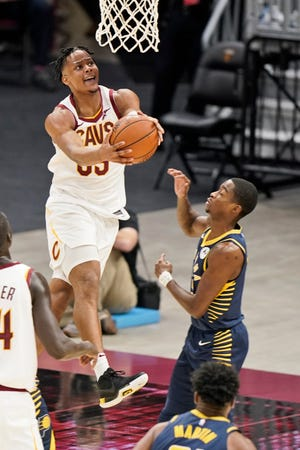 Cavaliers rookie forward Isaac Okoro (35) drives to the basket against the Indiana Pacers in the second half of an NBA preseason game. Cavs coach J.B. Bickerstaff wouldn't say if Okoro or Cedi Osman would start in the season opener Wednesday night. [Tony Dejak/Associated Press]