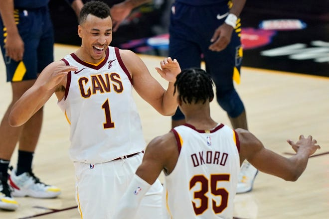 Cavaliers forward Dante Exum (1) celebrates with rookie Isaac Okoro during a game earlier this season. Exum has joined the list of injured Cavs and is expected to miss 6-to-8 weeks with a strained calf. Okoro has been cleared to return after missing time with a foot injury. [Tony Dejak/Associated Press]