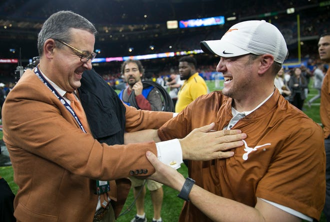 In happier times, Texas athletic director Chris Del Conte, left, and head coach Tom Herman congratulate each other after the Longhorns' 28-28 win over Georgia in the 2018 Sugar Bowl. Since that game, Texas has gone 14-8.