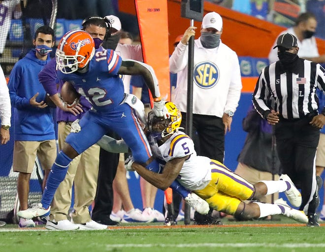 Florida wide receiver Rick Wells makes a catch near the sideline during Saturday night's 37-34 loss to LSU at Ben Hill Griffin Stadium in Gainesville, Fla.
