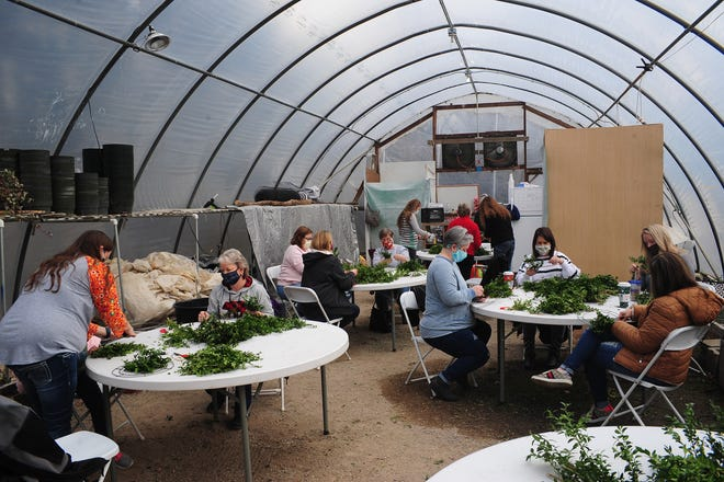 Attendees work to create holiday wreaths at Beech Creek Botanical Gardens and Nature Preserve's annual Fresh Williamsburg Wreath Workshop Saturday December 12, 2020. Michael Skolosh, Special to The Alliance Review