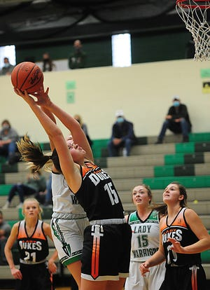 Marlington's Allison Lacher pulls down a rebound in her team's win at West Branch, Saturday, Dec. 12, 2020. (USA Today Network file photo)