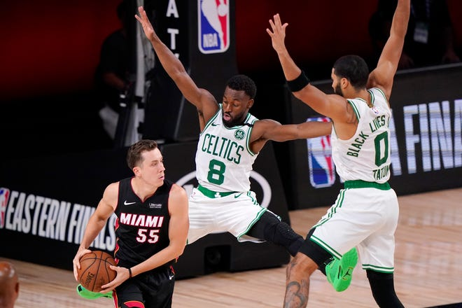 Miami's Duncan Robinson looks for help as Kemba Walker and Jayson Tatum defend in a playoff game in September.