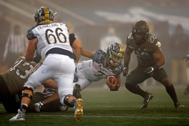 Navy quarterback Xavier Arline carries the ball in the first half against Army on Saturday in West Point, N.Y.
