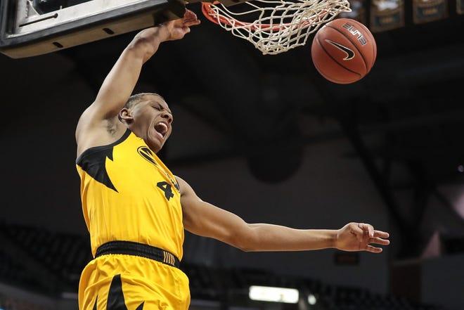 Missouri guard Javon Pickett (4) dunks the ball during a game against Illinois last season at Mizzou Arena.