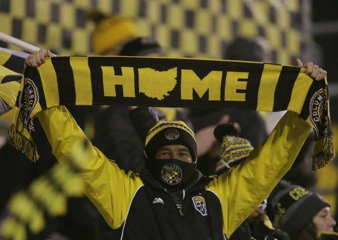 A Crew fan celebrates a goal by Derrick Etienne Jr.