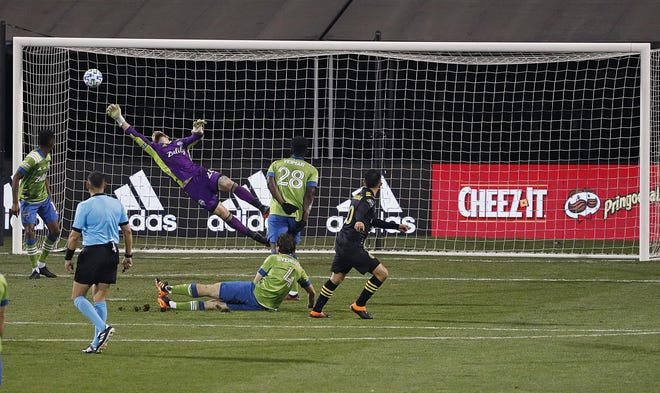 Lucas Zelarayan drives the ball past Sounders goalkeeper Stefan Frei to give the Crew a 3-0 lead.