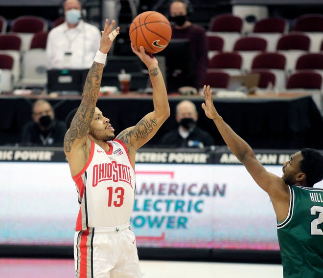 Ohio State Buckeyes guard CJ Walker (13) is guarded by Cleveland State Vikings guard Yahel Hill (2) during the first half of Sunday's NCAA Division I basketball game at Value City Arena in Columbus, Oh. on December 13, 2020.