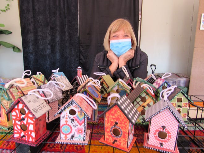 Artist Jan Jackson displays her handmade birdhouses and art during the December First Saturday Creative Bazaar Arts and Craft Market, hosted by the Palm Coast Arts Foundation.