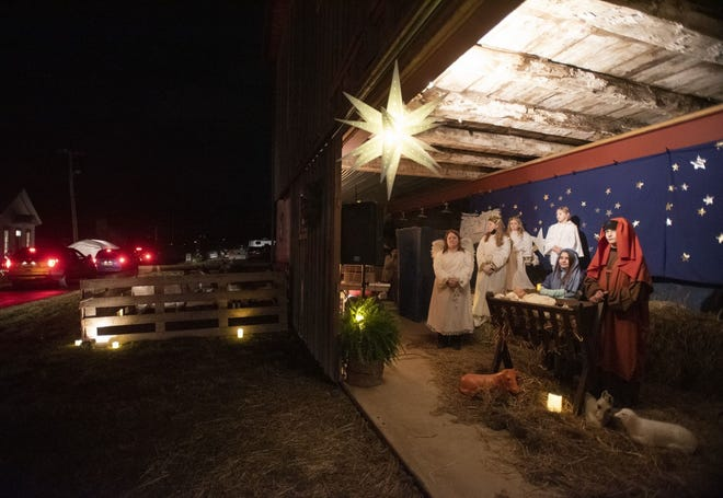 A live nativity was one of the highlights of the Hookstown Christmas Drive-Thru on Saturday night. Vehicles snaked through the Hookstown Fairgrounds to view the special event, sponsored by the South Side Historic Village Association, the Hookstown Grange and local churches. [Sally Maxson/For BCT]