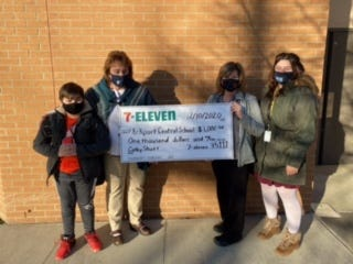Pictured from left to right: Xavior Smith, 6th grade student and franchisee's son, Claire Smith, K-6 Principal, Cathy Shutt, 7-Eleven Franchisee, and Jasmine Shutt, substitute teacher and franchisee's daughter.