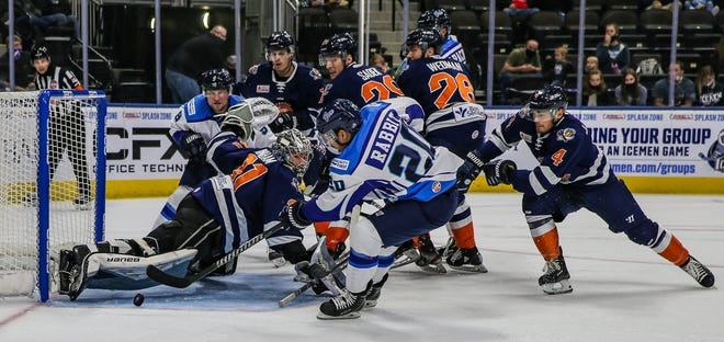 Icemen forward Wacey Rabbit (20) scores past Swamp Rabbits goaltender Jacob Ingham (31) during a Dec. 12 game.
