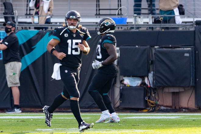 Jacksonville Jaguars quarterback Gardner Minshew (15) runs off the field after throwing a touchdown in the third quarter during the Jaguars vs. Titans game at TIAA Bank Field in Jacksonville, FL on Sunday, December 13, 2020.