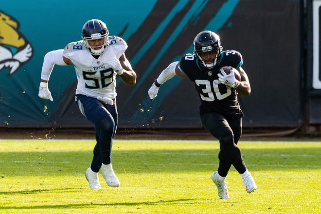Jaguars running back James Robinson (30) breaks free for a long rush against Tennessee on Dec. 13. The rookie running back will miss the Jaguars' season finale Sunday.