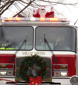 Santa Claus rode in style through the River Oak subdivision in Mills River on Saturday, waving to residents as his helpers handed out candy canes to children. River Oak was the first of many  neighborhoods visited by the Jolly Old Elf and his entourage.