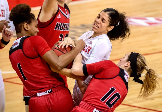 Bradley's Lasha Petree, middle, fights for a rebound with Northern Illinois' Errin Hodges (1) and Chelby Koker (10) in the first half Sunday, Dec. 13, 2020 at Renaissance Coliseum. The Braves defeated the Huskies 79-71.