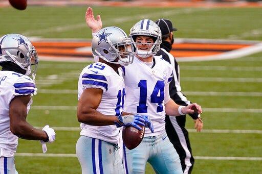 Dallas Cowboys quarterback Andy Dalton (14) celebrates a touchdown with wide receiver Amari Cooper (19) during the Cowboys' victory Sunday at Cincinnati.