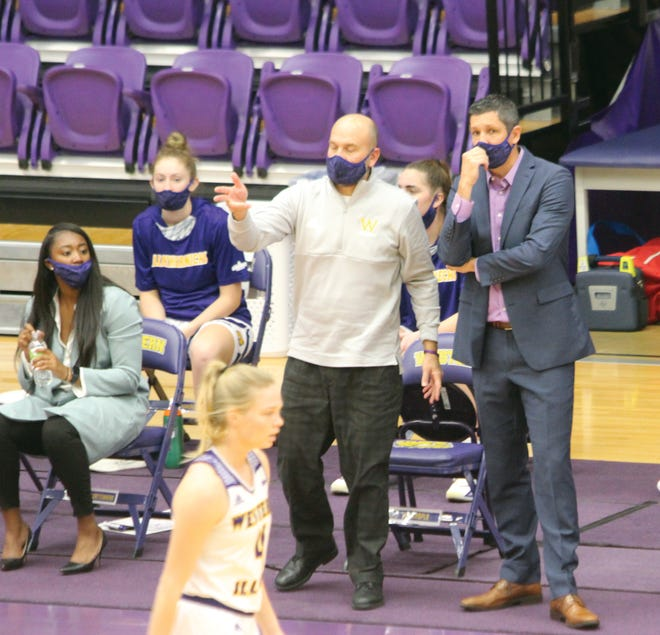 Western Illinois coach JD Gravina talks with coach Dan Chapla during a game.