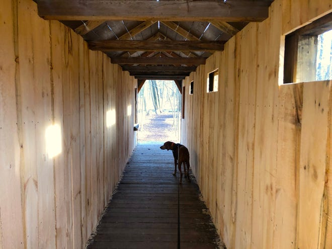 Inside the 35-foot-long covered bridge in Shortsville built by volunteers. The walls were constructed from two massive pallets that had been used to ship a giant piece of machinery from Germany to Rochester Insulated Glass.