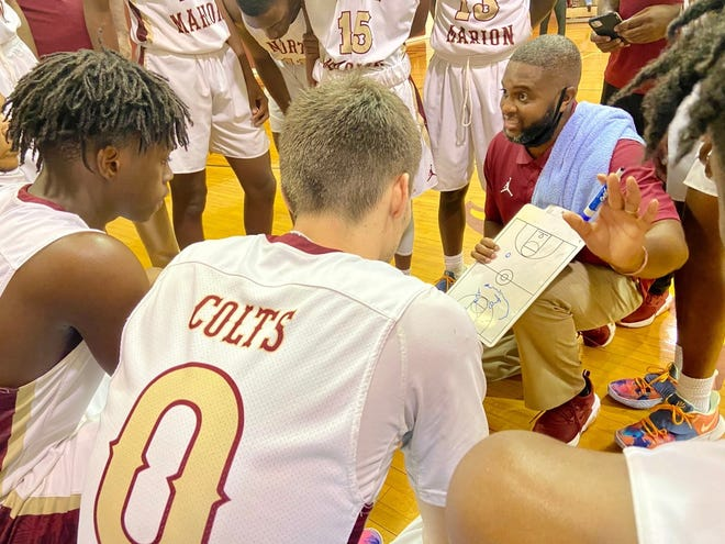 North Marion coach Tim Yarn draws up a play during a second-half timeout of Friday's Tim Brinkley Memorial game.