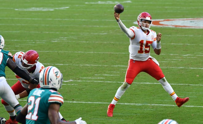 Kansas City Chiefs quarterback Patrick Mahomes (15) throws down the field against the Miami Dolphins in the second quarter at Hard Rock Stadium in Miami Gardens, December 13, 2020.